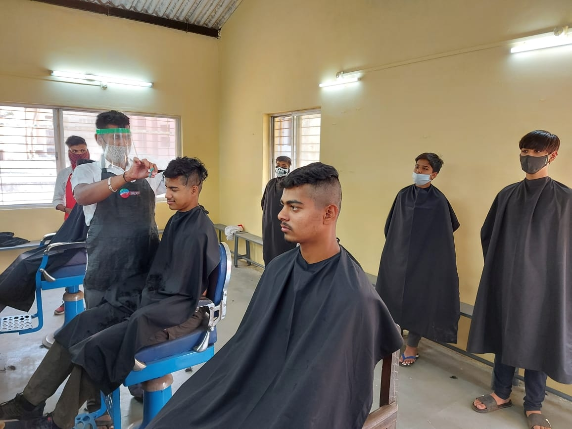 HAIRCUT BEING DONE WITH ALL COVID 19 PRECAUTIONS_1